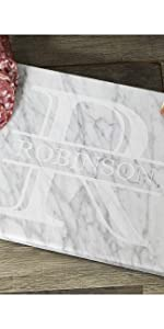 Engraved white marble serving board with monogram and last name