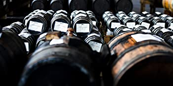 Battery of Wooden Barrels Aging Balsamic Vinegar