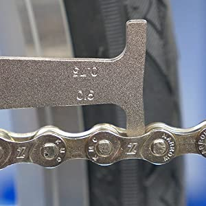 Bicycle chain with zero percent wear as measured by Park Tool CC-3.2 Chain Checker