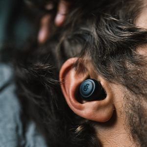 male, ear, model, earbuds, on, black, logo, hair, beard, fingers