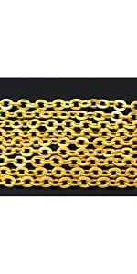 gold necklace chains on a black background