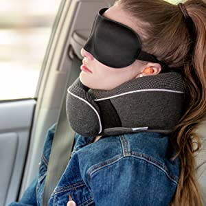 woman wearing neck pillow in a car.