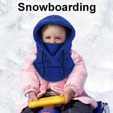 A girl playing with a snowboard