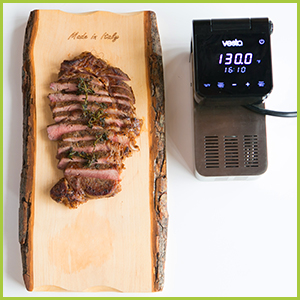 top view of perfectly cooked steak with the Imersa Elite sous vide machine black