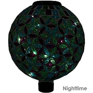 gazing globe lit up at night