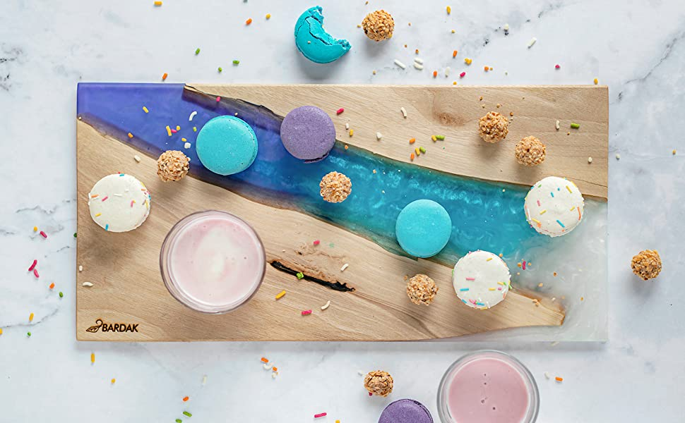 purple blue white BARDAK cheese board with pink smoothy on top and colorful macaroons all over