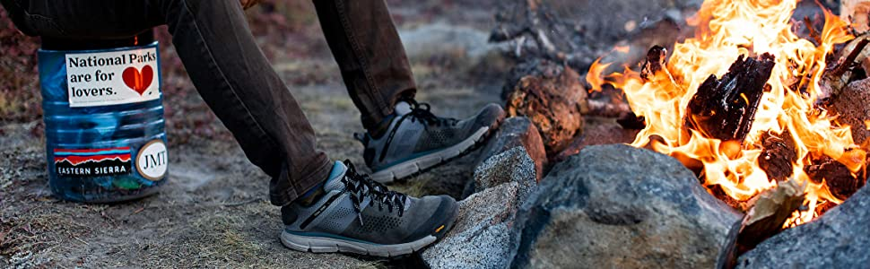 hiking shoe near a bonfire