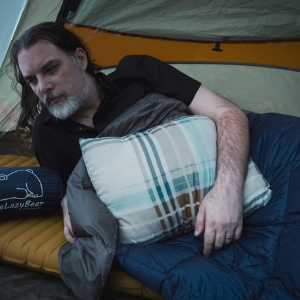 Hiker in Tent with Blanket