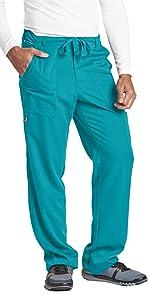 model wearing Men's Grey's Anatomy Big 6-Pocket Zip Fly Drawstring Scrub Pant