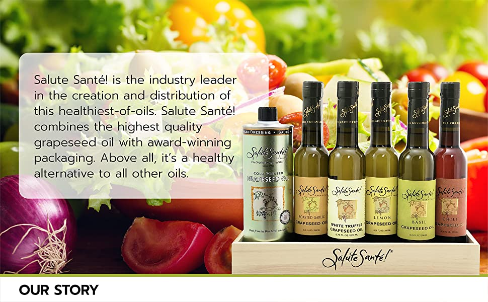 Display box of several Salute Santé oils in foreground with a variety of vegetables in background.