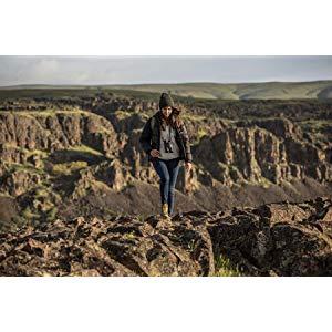 woman hiking on canyon