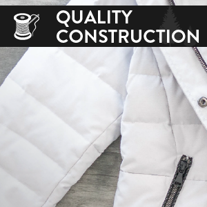 "A white coat with an illustration of a needle and thread in front of it. Says ""quality construction"""