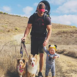 family hiking with dogs