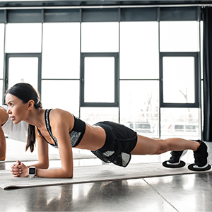 Woman doing planks in a gym using Limm Core Sliders