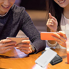 USB C power bank with dual USB output for 2 devices.