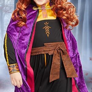 anna costume closeup, movie hero, colorful cape, costume details closeup, vibrant colors