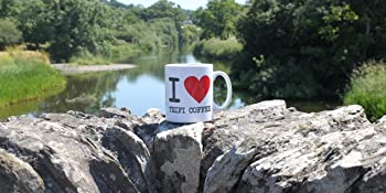 Cup of Teifi coffee next to River Teifi in South West Wales