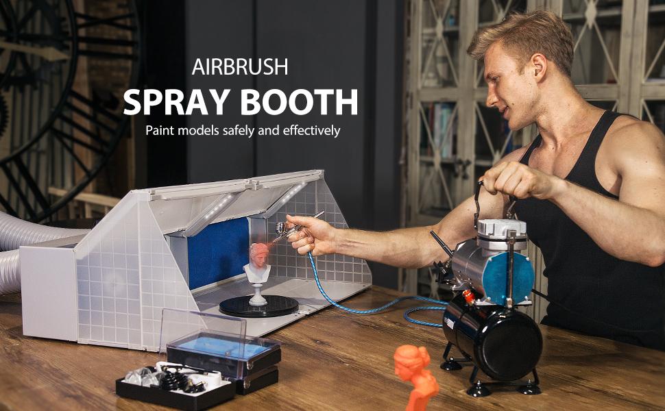 airbrush spray booth with spray gun on desk
