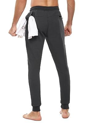 pantalones de chándal ajustados con cremallera bolsillos