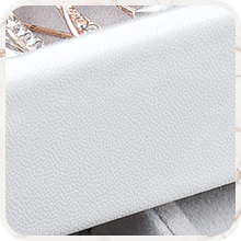 Made of water-resistant PU leather, the white box is easy to clean and long lasting.