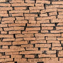 Cork oak bark flattened out enabling our farmers to start the process of making our range