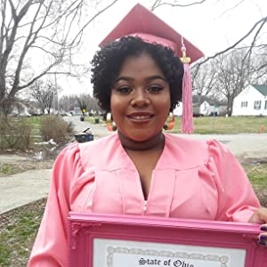 pink graduation cap and gown