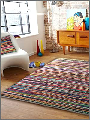 Multi color chindi rags rug and throw pillow in a bohemian chic modern living/family room