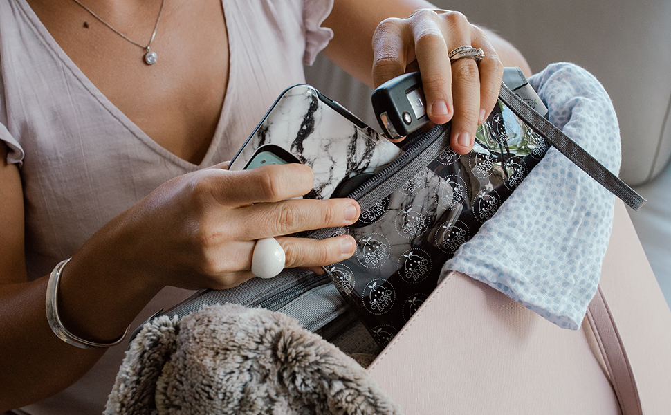 Lifestyle photo - Personal pouch being used to hold mobile phone and keys