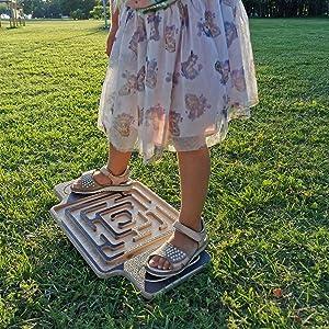 girl on a maze wobble board