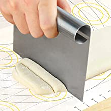 Cutting dough on xxl pastry mat with measurements