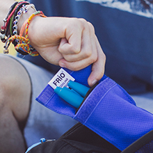 Man pulling insulin pen out of a FRIO wallet
