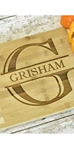 Engraved bamboo cutting board with monogram letter and last name