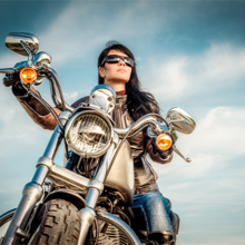 WOMAN MOTORCYLE RIDER WITH SUN READING GLASSES