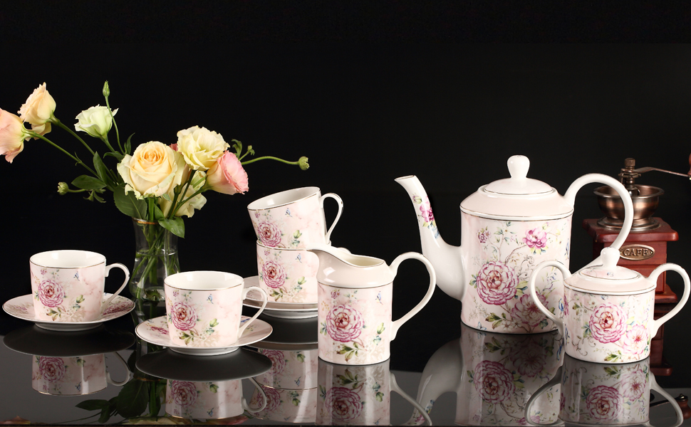 fine porcelain teapot with cup and saucer