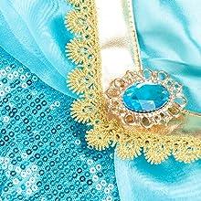 Precioso broche de diamantes de imitación con purpurina.