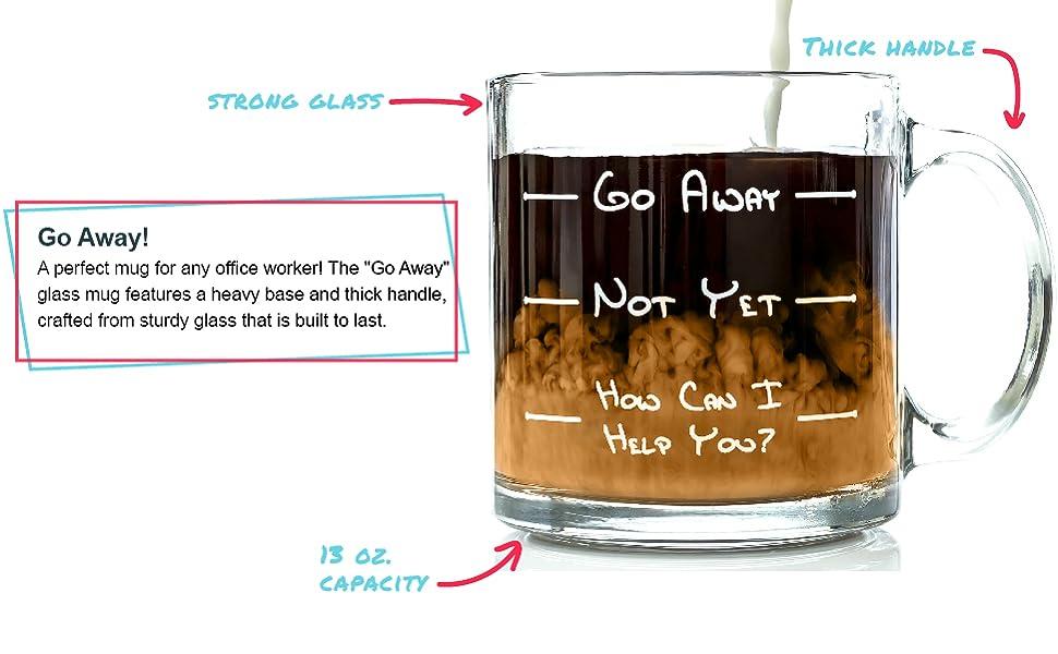 Glass coffee mug with coffee and yellow cream swirl