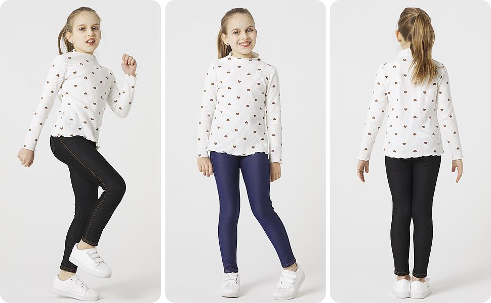 Una niña en pantalones verano combinar con jerséis, hacer mover mayor libertad.