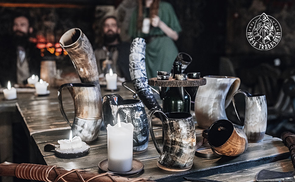 Spread of drinking horns and tankards on tavern table