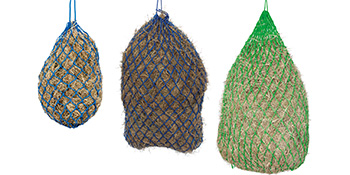 Image of three sizes of haynets with hay on a white background