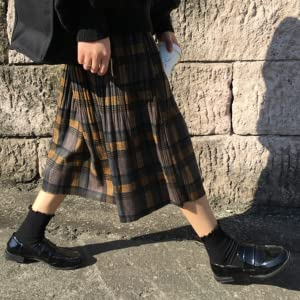Trendy check skirt with styling accents.
