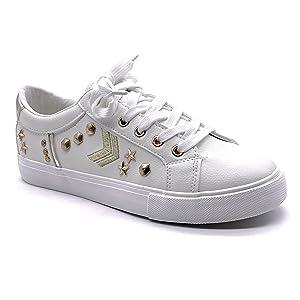 scarpe da ginnastica bianche con borchie d'oro