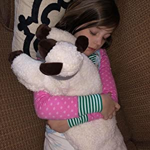young girl snuggling and sleeping with her huggaroo weighted lap pad