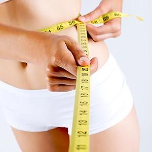 woman measuring waist size