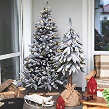 Künstliche Weihnachtsbäume mit Schneeflocken