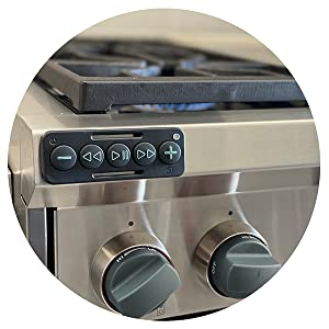 Chubby Buttons 2 stuck on the kitchen stove. Perfect for controlling your phone remotely.