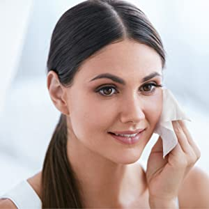 woman using face wipe as makeup remover for sensitive skin