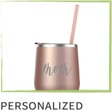 """Photo of a tumbler mug with """"Mom"""" engraved across the side. Text below reads, """"Personalized."""""""