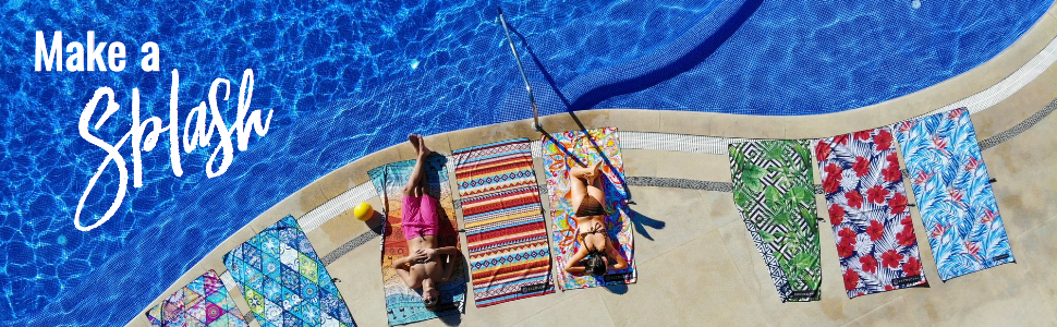 Man and woman laying on ECCOSOPHY microfiber towels by the pool