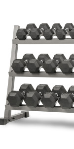 A zoomed-in view of an XMark 3-Tier Dumbbell Rack with rubber-coated hex dumbbells on it, 550 lb set