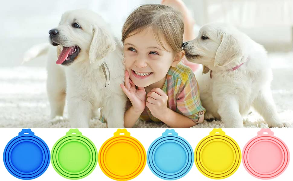 a cute little girl with 2 dogs, below are 6 different can lids